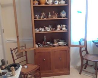 Display cabinet with shelves above and double doors below