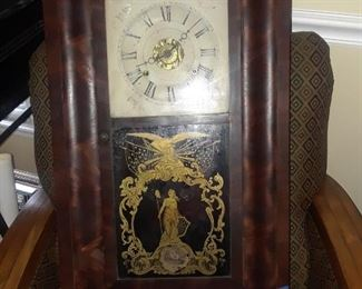 Mantle clock with elaborate decoration  on glass front, 19th c.