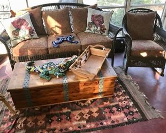 Wicker Couch, Chest/Coffee Table, Mexican Pottery Animals, SW Rug, and Large Basket...