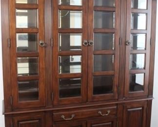 """Haverty's Cherrywood china cabinet with lighting, measures 62"""" wide, 90"""" tall, 16"""" deep"""