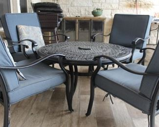 Patio table and chairs - table has a fire bowl in the middle