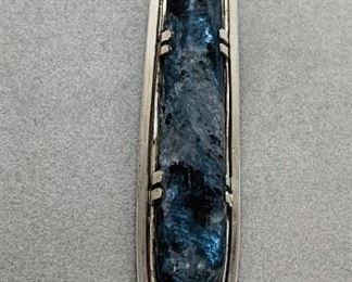 Labadorite in sterling silver with sky blue topaz pendant.