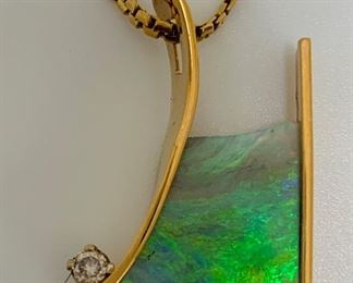 5 carats of Australian black opal with .03 diamond in 14kt yellow gold pendant.