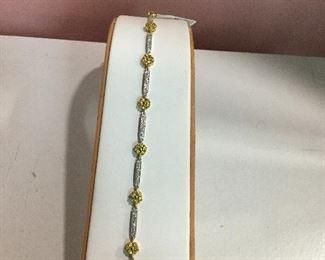 White gold, diamond and yellow sapphire bracelet