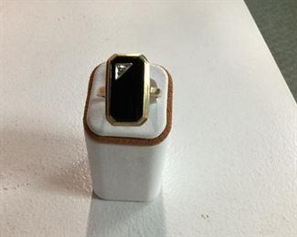 Yellow gold, onyx and diamond ring