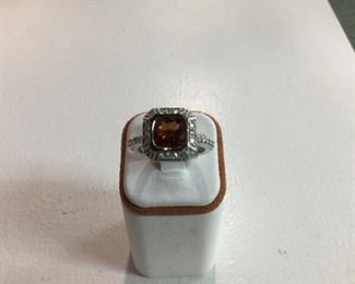 White gold, garnet and diamond ring