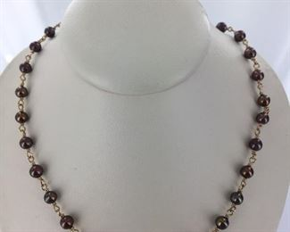 Yellow gold and chocolate pearl necklace