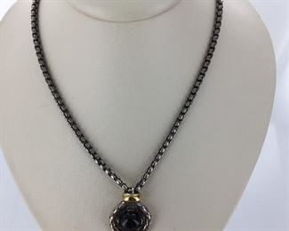 Silver, yellow gold and onyx necklace