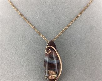 Jasper and ruby set in Sterling Silver and 14 Kt Rose Gold pendant.
