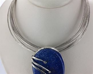 Lapis and diamond pendant set in Sterling Silver.