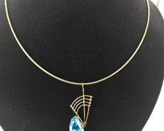 Swiss Blue Topaz set in a 14 Kt White and Yellow Gold Pendant.