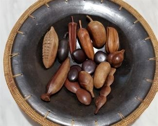 This highly decorative bowl has African stones and nuts inside.
