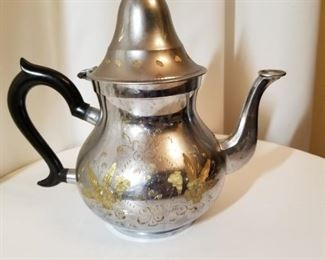 Tea pot with brass embellishment