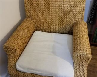Wicker chair, with cushion.