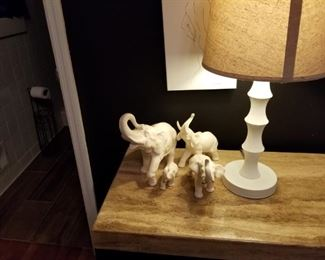 Elephants, smaller desk lamp matches tall on, marble top table, one other one same size, also 9 chest of drawers w/ marble top in another photo