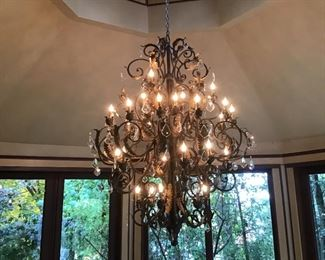 Large wrought iron and crystal chandelier