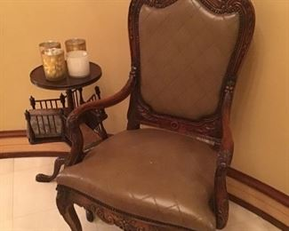 One of a pair of quilted leather chairs