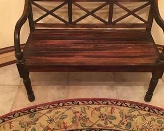 Teak bench, round Oriental carpet