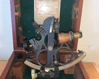 1942 Antique Husun Sextant Made By H. Hughes & Sons LTD. London in Wood Case.  Used for measuring the angular distances between objects and especially for taking altitudes in navigation.