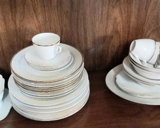 Vintage white dishes, great for the holidays with red decor
