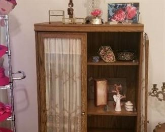 Small cabinet with glass doors and vintage German curtains