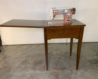 wood sewing table with pink pfeifers de luxe sewing machine
