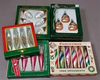 2 table of vintage ornaments and tree toppers