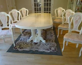 Different view of the dining set, showing the chairs more clearly than the prior picture.