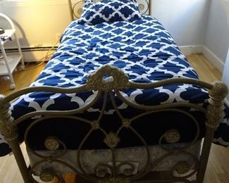 Twin size bed with a head and foot gold-colored frame. Comes with a mattress and base set.