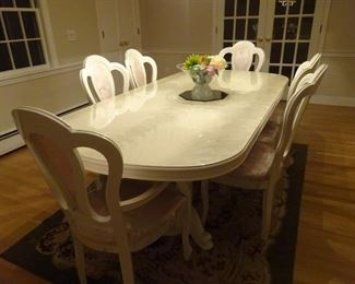 Glossy finished dining room set and 6 chairs. All look new. The table is extendable and can seat 2 more if needed.