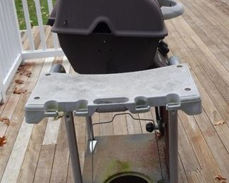 Side view of BBQ. The round hole is where the gas cylinder fits.