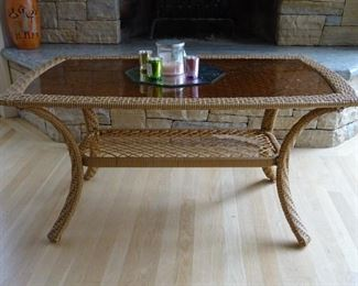 Coffee table with a glass top.