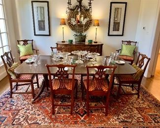 Stunning antique rug, set of 8 dining chairs, and a mirror to die for!