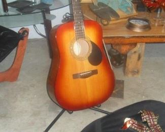 Greg Bennett series acoustic guitar w/case and shoulder strap. Music books available