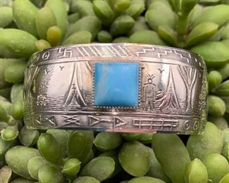 Vintage sterling silver and turquoise storyteller cuff bracelet with teepees and whirling logs, Native American