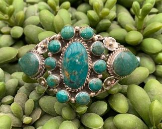 Vintage sterling silver cuff bracelet with floral motif, Native American. Not sure of the stones but they may be green turquoise.