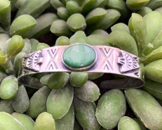 Vintage sterling silver and turquoise cuff bracelet with an arrowhead motif, Native American