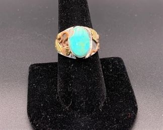 Newer sterling silver and turquoise ring with copper and brass accents, Native American