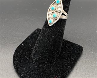 Vintage sterling silver and turquoise ring with floral motif, Native American Navajo