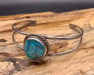 Vintage sterling silver cuff bracelet with turquoise centerpiece, Native American Navajo