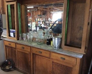 . . . I love this rare, one-of-a-kind piece -- originally a pharmacy counter -- can you imagine this in your basement or special room as the focal point?