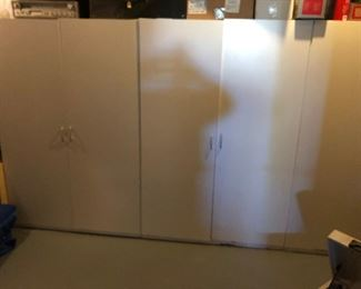 Large white storage cabinets
