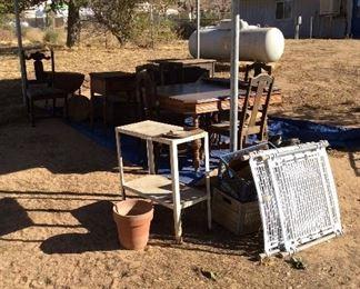 Vintage furniture, work shelves, dog gate.