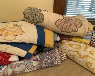 Antique hand sewn quilts and blankets