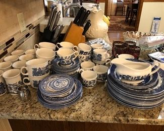 Various sets of Churchhill Blue Willow plates, bowls, mugs, serving pieces