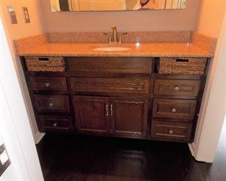 Bathroom vanity with granite top , sink and faucet