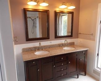Double vanity  granite top  sinks  faucets mirrors light fixtures