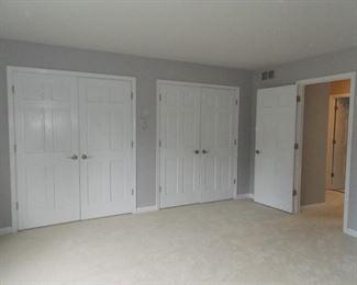 wood  6 panel closet doors  carpeting