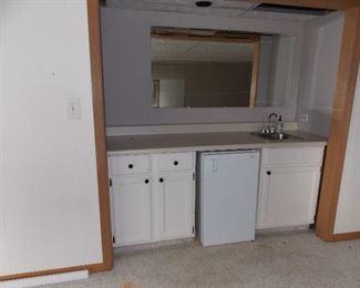 Mini Frig  bar sink  cabinets mirror
