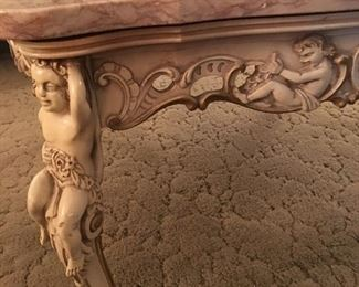 Hand carved thick marble top coffee table.